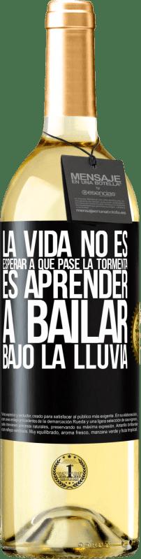 24,95 € Envío gratis | Vino Blanco Edición WHITE La vida no es esperar a que pase la tormenta. Es aprender a bailar bajo la lluvia Etiqueta Negra. Etiqueta personalizable Vino joven Cosecha 2020 Verdejo
